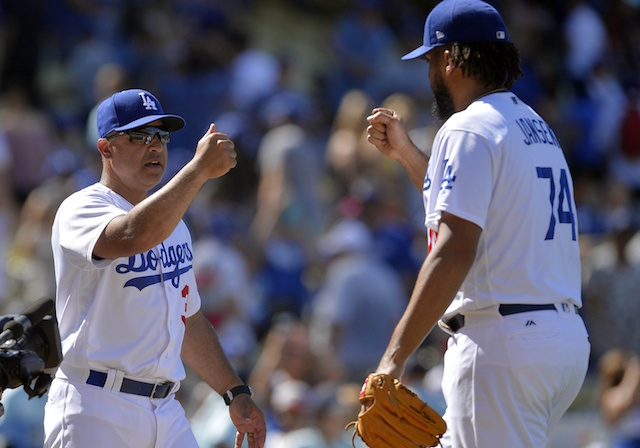 Los Angeles Dodgers manager Dave Roberts and Kenley Jansen celebrate after a win