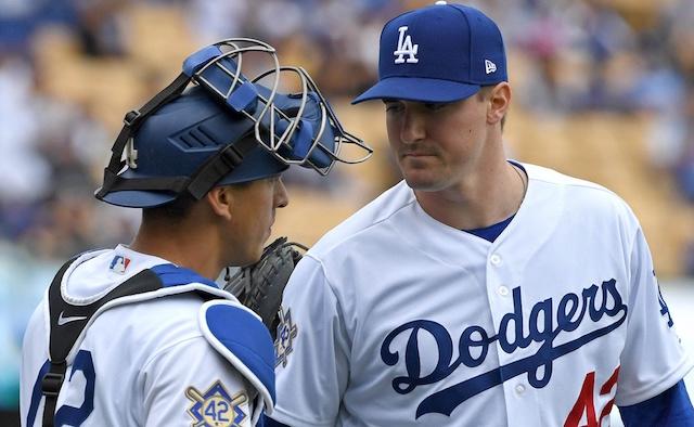 Los Angeles Dodgers catcher Austin Barnes speaks with Ross Stripling