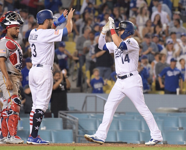 Los Angeles Dodgers teammates Chris Taylor and Kiké Hernandez celebrate a home run