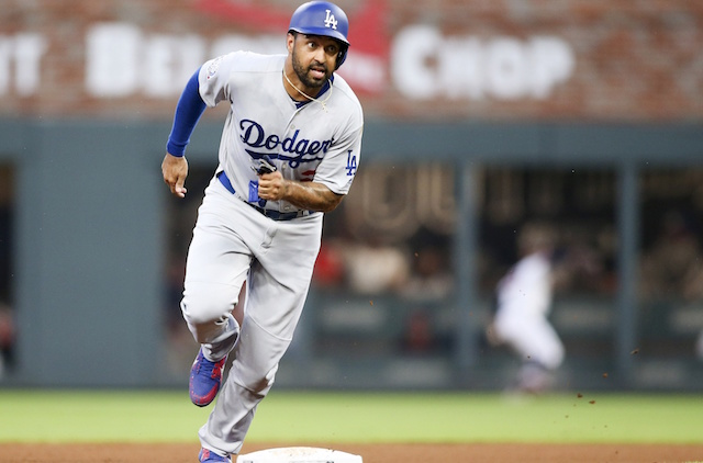 Dodgers hit three HRs, beat Braves in NLDS opener
