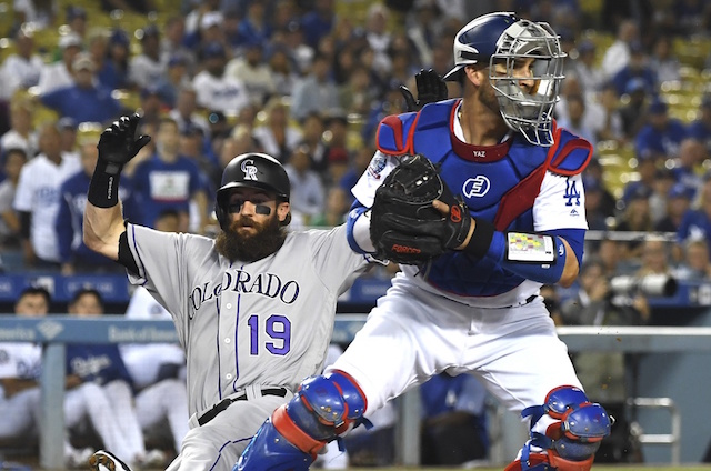 Dodgers clinch playoff berth as NL division races come down to wire