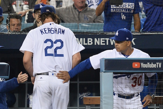 Los Angeles Dodgers manager Dave Roberts congratulates starting pitcher Clayton Kershaw