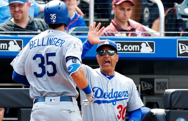 Los Angeles Dodgers manager Dave Roberts congratulates Cody Bellinger