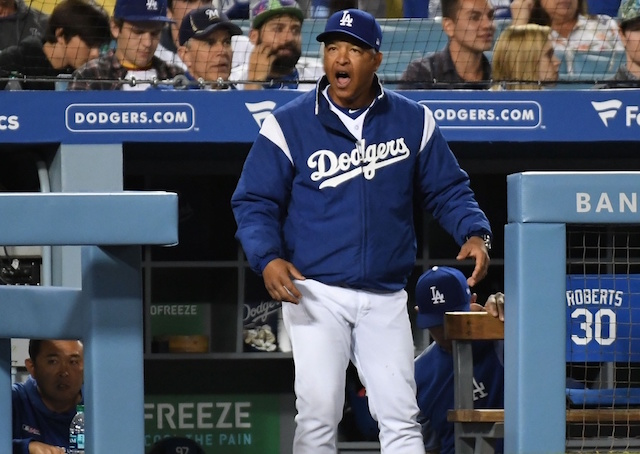 Los Angeles Dodgers manager Dave Roberts reacts during a game