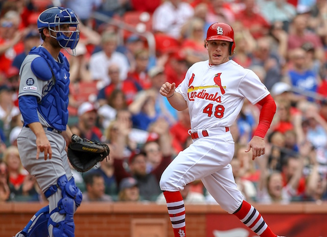 Los Angeles Dodgers catcher Austin Barnes looks on as St. Louis Cardinals outfielder Harrison Bader scores a run