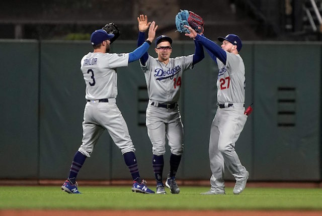 Kiké Hernandez, Chris Taylor and Alex Verdugo celebrate after a Los Angeles Dodgers win
