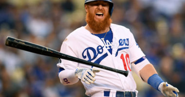 Los Angeles Dodgers third baseman Justin Turner reacts after being hit by a pitch
