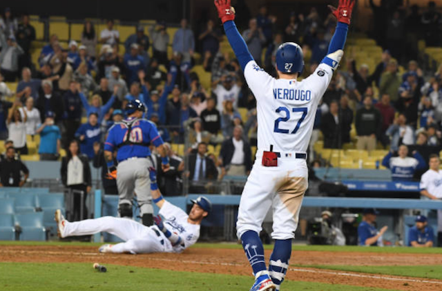 Alex Verdugo celebrates as Cody Bellinger scores a game-winning run in a walk-off win for the Los Angeles Dodgers