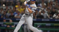Los Angeles Dodgers shortstop Corey Seager hits an RBI single against the Pittsburgh Pirates