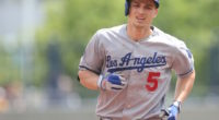 Los Angeles Dodgers shortstop Corey Seager rounds the bases after hitting a home run against the Pirates