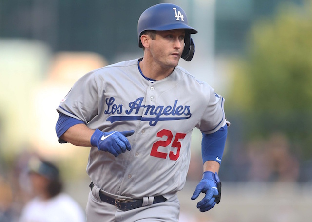 Los Angeles Dodgers infielder David Freese rounds the bases after hitting a grand slam at PNC Park
