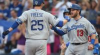 Los Angeles Dodgers infielder David Freese celebrates with Russell Martin after hitting a grand slam