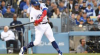 Los Angeles Dodgers second baseman Kiké Hernandez swings for a pinch-hit home run against the New York Mets