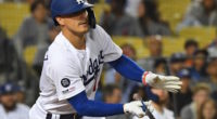 Los Angeles Dodgers second baseman Kiké Hernandez hits an RBI single against the New York Mets
