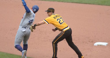 Los Angeles Dodgers infielder Matt Beaty attempts to avoid a tag during a game against the Pittsburgh Pirates