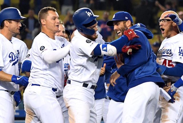 Matt Beaty, David Freese, Joc Pederson, Chris Taylor and Alex Verdugo celebrate a Los Angeles Dodgers walk-off win
