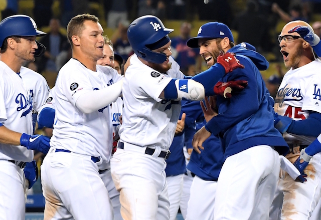 Matt Beaty, David Freese, Joc Pederson, Chris Taylor and Alex Verdugo celebrate a Los Angeles Dodgers walk-off win