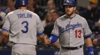 Los Angles Dodgers teammates Max Muncy and Chris Taylor celebrate during a game against the Pittsburgh Pirates