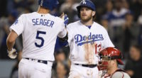 Los Angeles Dodgers shortstop Corey Seager celebrates with infielder Max Muncy after hitting a home run against the Philadelphia Phillies