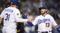 Los Angeles Dodgers infielder Max Muncy celebrates with outfielder Joc Pederson after hitting a home run against the Philadelphia Phillies