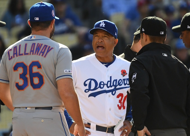 New York Mets manager Mickey Callaway and Los Angeles Dodgers manager Dave Roberts speak with umpires prior to a game at Dodger Stadium