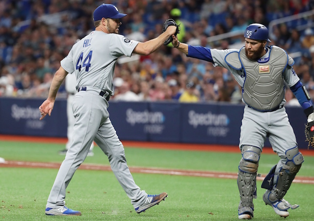 Los Angeles Dodgers starting pitcher Rich Hill and Russell Martin celebrate