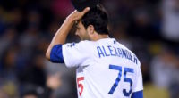 Los Angeles Dodgers relief pitcher Scott Alexander reacts after allowing a grand slam against the New York Mets