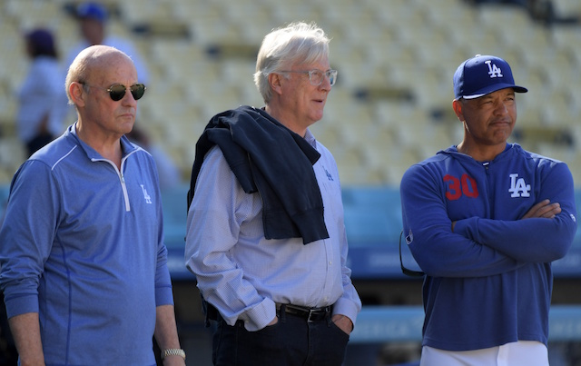 Los Angeles Dodgers president and CEO Stan Kasten, manager Dave Roberts and owner Mark Walter watch batting practice at Dodger Stadium