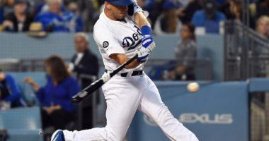 Los Angeles Dodgers catcher Austin Barnes hits a single against the Chicago Cubs