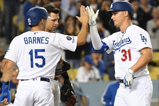 Los Angeles Dodgers catcher Austin Barnes celebrates with Joc Pederson after a home run against the San Francisco Giants