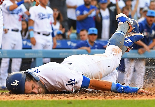Los Angeles Dodgers shortstop Chris Taylor dives into home plate against the Chicago Cubs