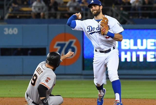 Los Angeles Dodgers shortstop Chris Taylor makes a throw to first base