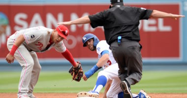 Los Angeles Dodgers infielder Chris Taylor steals second base against the Philadelphia Phillies