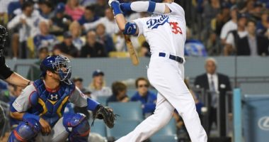 Los Angeles Dodgers right fielder Cody Bellinger hits a home run off Chicago Cubs starting pitcher Jon Lester