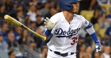 Los Angeles Dodgers right fielder Cody Bellinger hits a home run against the Colorado Rockies