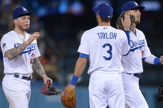 Cody Bellinger, Chris Taylor and Alex Verdugo celebrate after a Los Angeles Dodgers win at Dodger Stadium