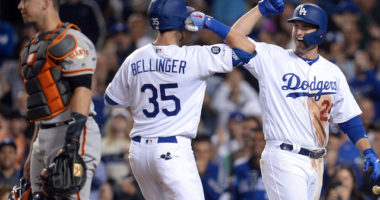Los Angeles Dodgers teammates Cody Bellinger and David Freese celebrate after a home run against the San Francisco Giants