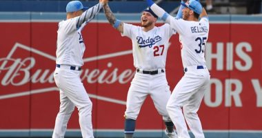 Cody Bellinger, JocPederson and Alex Verdug celebrate after the Los Angeles Dodgers defeat the Chicago Cubs