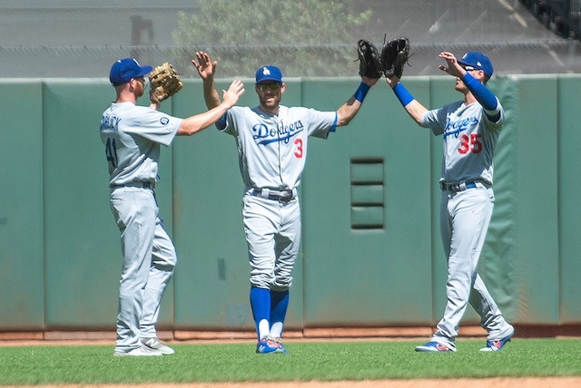 Los Angeles Dodgers outfielders Cody Bellinger, Kyle Garlick and Chris Taylor celebrate after a win against the San Francisco Giants