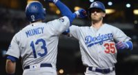 Los Angeles Dodgers teammates Cody Bellinger and Max Muncy celebrate after a home run