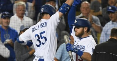 Los Angeles Dodgers right fielder Cody Bellinger celebrates with Max Muncy after hitting a home run against the Chicago Cubs