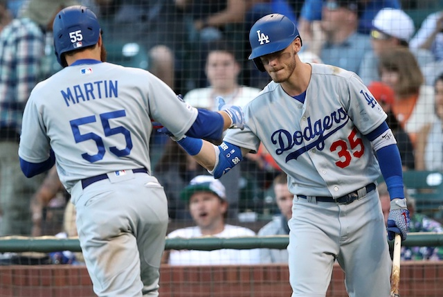 Los Angeles Dodgers first baseman Cody Bellinger congratulates Russell Martin