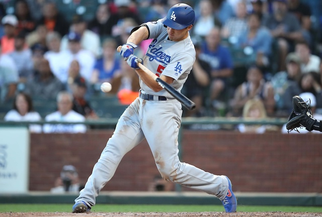 Los Angeles Dodgers shortstop Corey Seager hits a double against the San Francisco Giants
