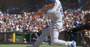 Los Angeles Dodgers shortstop Corey Seager gets a hit against the San Francisco Giants