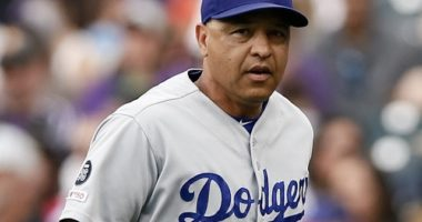 Los Angeles Dodgers manager Dave Roberts runs onto the field for a pitching change against the Colorado Rockies