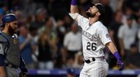 Los Angeles Dodgers catcher Russell Martin looks on as Colorado Rockies left fielder celebrates a home run at Coors Field