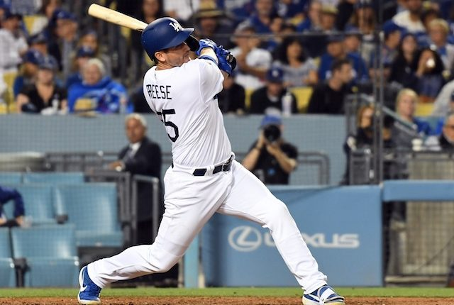 Los Angeles Dodgers first baseman David Freese hits a home run against the Chicago Cubs