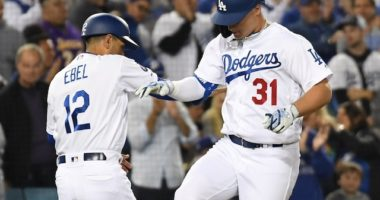 Los Angeles Dodgers third base coach Dino Ebel celebrates with Joc Pederson after a home run against the San Francisco Giants