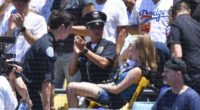 Fan is taken away from a game at Dodger Stadium after being hit by a foul ball