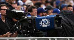 General view of a Fox Sports camera and cameraman at Coors Field